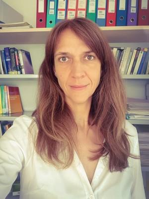 ANNA M. PALAU